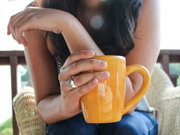 woman taking coffee break: photo link to parent carer breaks in Cambridgeshire