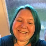 head and shoulders pic of woman with blue hair