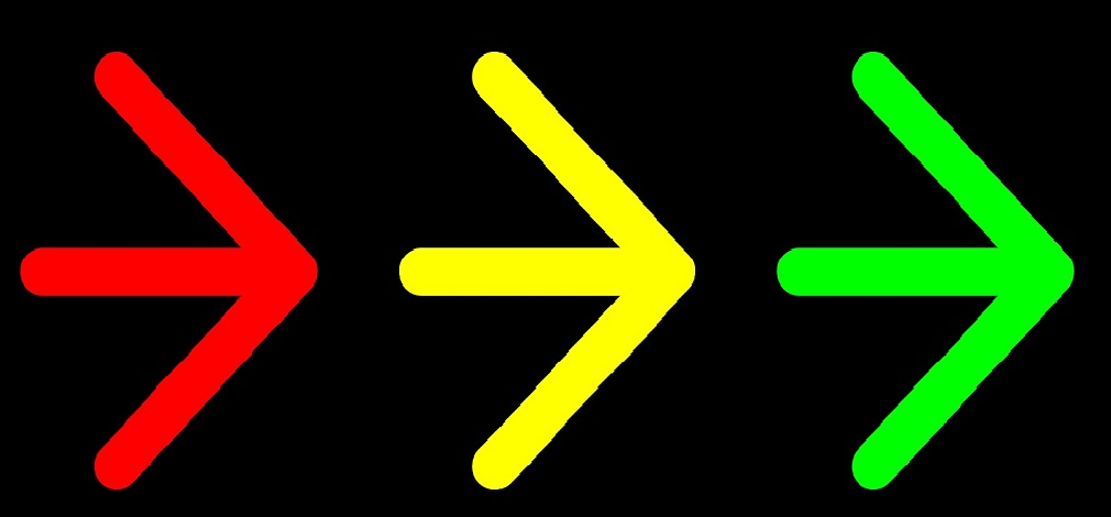 red yellow and green arrows on black background