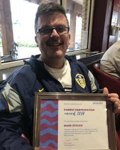 Pinpoint volunteer with award
